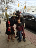 Chimney sweepers from the xmas play walking down Main St